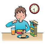 boy has breakfast